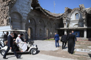 Pope Francis, is shown the devastation of Syrian Catholic Cathedral the 4-church complex at Hosh al-Bieaa Church Square, after a prayer of suffrage for the victims of the war at Church Square, Mosul, Iraq 7 March 2021. Pope Francis is visiting Iraq for the Apostolic Journey from 5 to 8 March 2021. ANSA/ALESSANDRO DI MEO